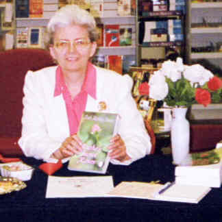 Author Ruth Marlene Friesen, with her first novel, Ruthe's Secret Roses, at her very first book signing, June 15, 2002, at Blessings Christian Marketplace, Saskatoon, SK.