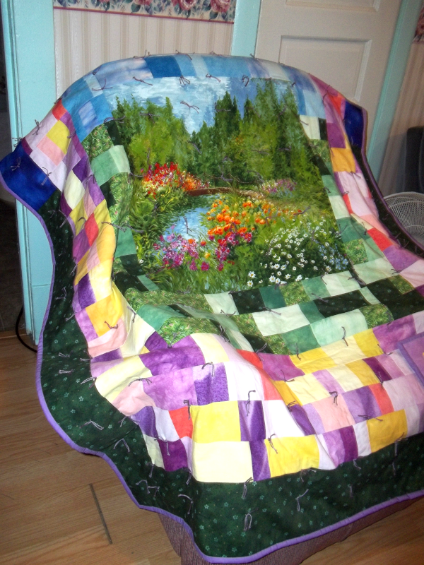 beautiful quilt spread over my recliner